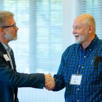 Speaker and attendee shaking hands